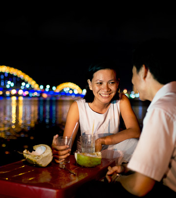 Couple have their drinks looking at the illuminated Dragon Bridge - Philips