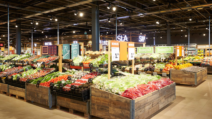 A well-stocked fresh fruit and vegetables section of an Albert Heijn supermarket. - smart retail lighting